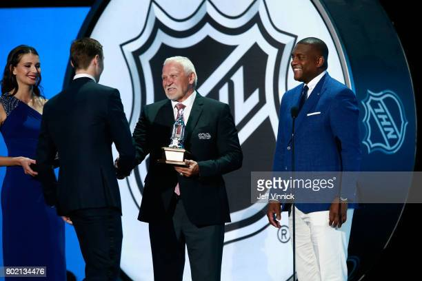 Former NHL players Bernie Parent left and Kevin Weekes greet Sergei Bobrovsky of the Columbus Blue Jackets onstage after Bobrovsky won the Vezina...