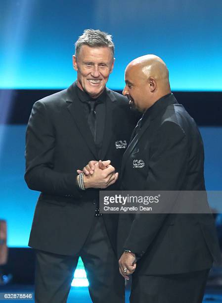 Former NHL players Borje Salming left and Grant Fuhr shake hands onstage during the NHL 100 presented by GEICO show as part of the 2017 NHL AllStar...