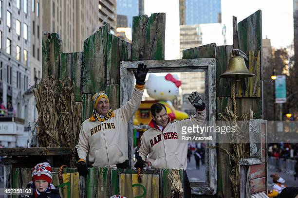 Former NHL players Cam Neely and Mike Richter wave to people watching on the street from the Discover and NHL's Frozen Fall Fun float in the 87th...