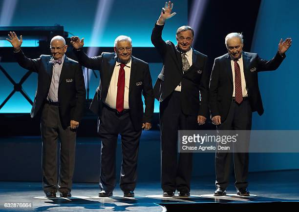 Former NHL players David Keon Johnny Bucyk Serge Savard and Red Kelly wave to the audience as he takes the stage during the NHL 100 presented by...