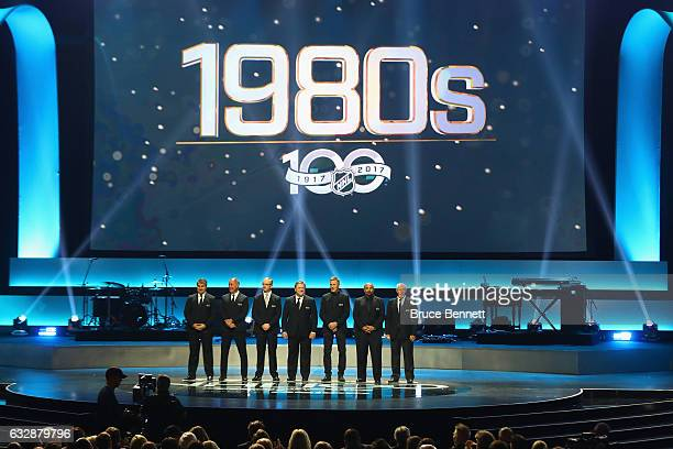 Former NHL players from the 1980s stand on the stage during the NHL 100 presented by GEICO Show as part of the 2017 NHL AllStar Weekend at the...