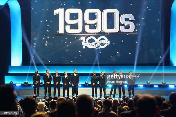 Former NHL players from the 1990s stand on the stage during the NHL 100 presented by GEICO Show as part of the 2017 NHL AllStar Weekend at the...
