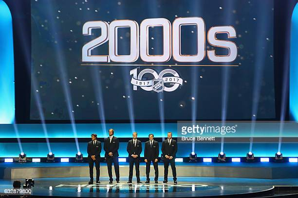 Former NHL players from the 2000s stand on the stage during the NHL 100 presented by GEICO Show as part of the 2017 NHL AllStar Weekend at the...