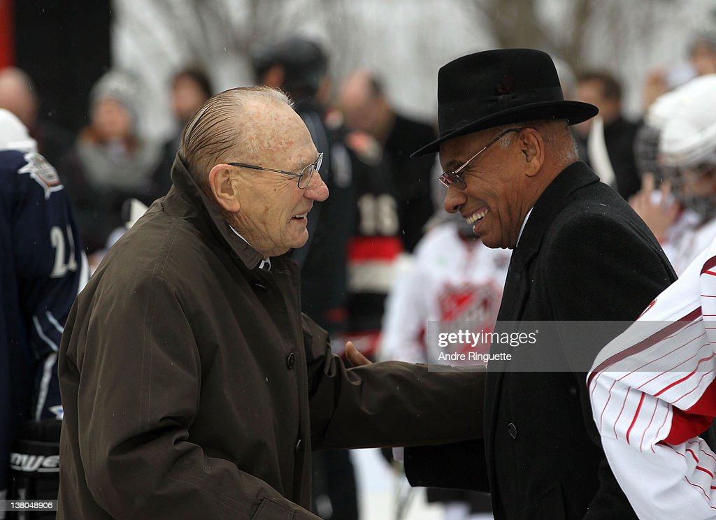 Former NHL players Johnny Bower (L) and Willie O'Ree greet one another at the 2012 NHL All-Star Game - H.E.R.O.S. Community Program Launch at Rideau Hall on January 28, 2012 in Ottawa, Ontario, Canada.