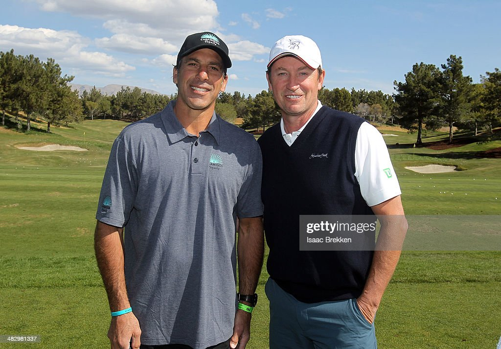 Former NHL players Wayne Gretzky (R) and Chris Chelios attend Aria Resort & Casino's 13th Annual Michael Jordan Celebrity Invitational at Shadow Creek on April 5, 2014 in North Las Vegas, Nevada.