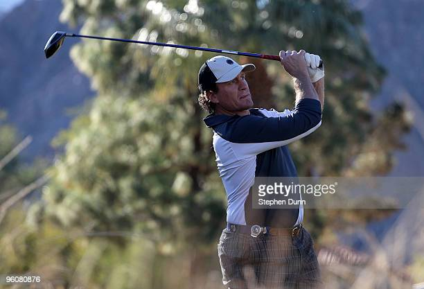 Former NHL star Jeremy Roenick hits his tee shot on the ninth hole on the Nicklaus Private course at PGA West during the third round of the Bob Hope...