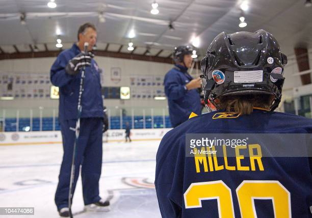 Former NHLer Dave Andreychuk gives instruction as a young participant listens at the hockeyville skills clinic as part of the Kraft Hockeyville 2010...