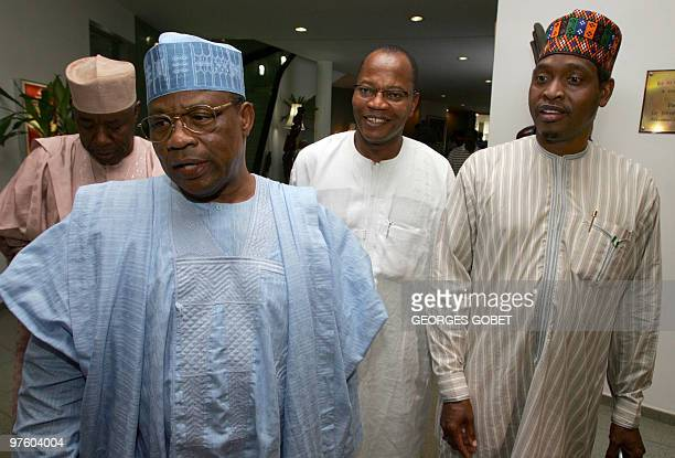 Former Nigerian President Ibrahim Babangida and Commission President of the Economic Community of West African States Mohamed Ibn Chambas with an...
