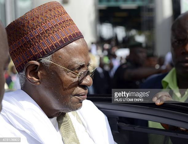 Former Nigerian President Shehu Shagari arrives to attend the inauguration of new Nigerian President at the Eagles Square in Abuja on May 29 2015...