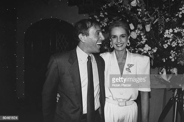 Former nightclub owner Steve Rubell posing w fashion designer Carolina Herrera at NEW YORK magazine's 20th anniversary party NYC