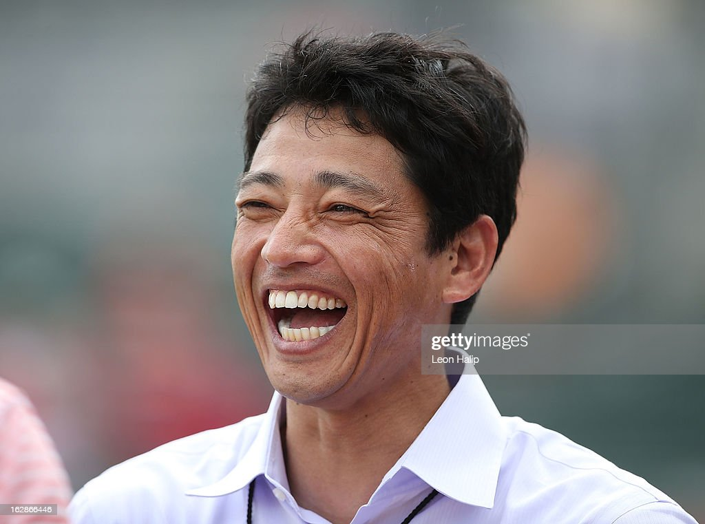 Former Nippon Professional Basebal Member <a gi-track='captionPersonalityLinkClicked' href=/galleries/search?phrase=So+Taguchi&family=editorial&specificpeople=183399 ng-click='$event.stopPropagation()'>So Taguchi</a> watches the pregame warms ups prior to the start of the game between the St. Louis Cardinals and the Boston Red Sox on February 26, 2013 in Fort Myers, Florida.