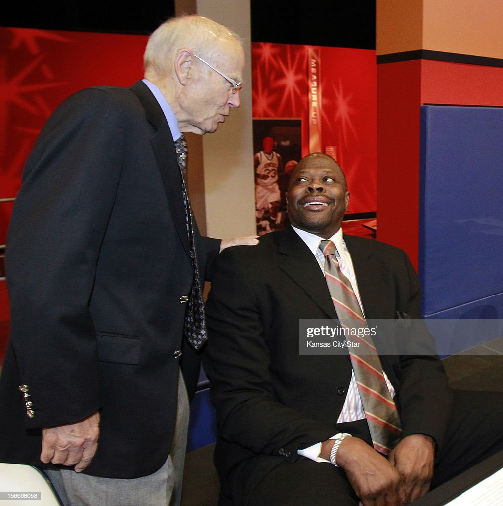 Former North Carolina coach Bill Guthridge visits with former Georgetown great Patrick Ewing during ceremonies for the National Collegiate Basketball Hall of Fame on Sunday, November 18, 2012, in Kansas City, Missouri.
