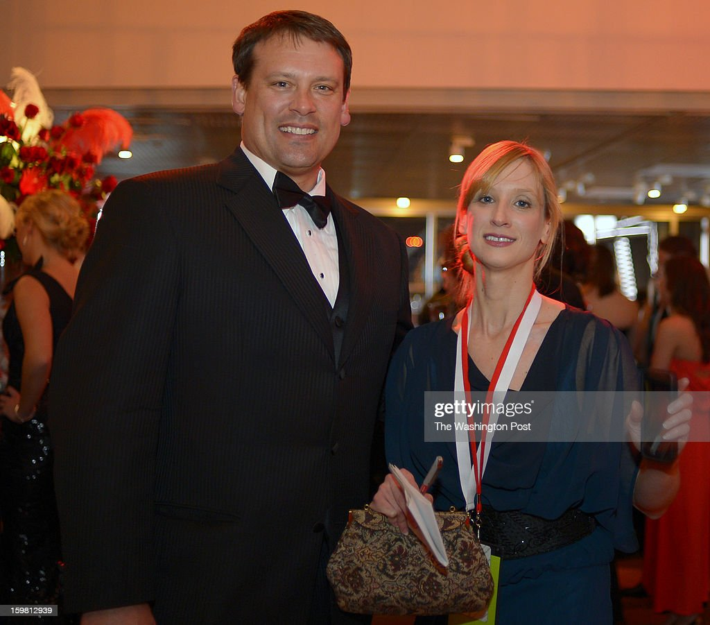 Former North Carolina congressman and Redskins quarterback Heath Shuler, left, poses witheStyle writer Monica Hesse at the North Carolina Ball at Nationals Stadium. She race from inaugural ball to ball against fellow writer Dan Zak during a treasure hunt competition in Washington DC, January 194, 2012 .