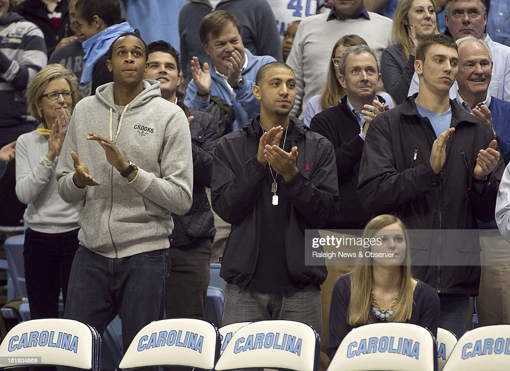 Former North Carolina Tar Heels (left to right) John Henson, Kendall Marshall, and Tyler Hansbrough applaud as Tyler Zeller has his number 44 jersey honored during halftime of the game between UNC and Virginia at the Smith Center in Chapel Hill, North Carolina, Saturday February 16, 2013. UNC beat Virginia, 93-81.