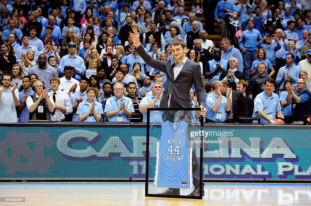Former North Carolina Tar Heels player Tyler Zeller waves to the crowd as his jersey number is honored during a ceremony at halftime of the game against the Virginia Cavaliers at the Dean Smith Center on February 16, 2013 in Chapel Hill, North Carolina. North Carolina won 93-81.