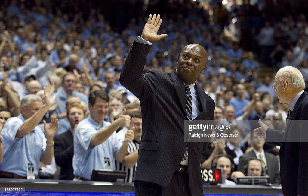 Former North Carolina Tar Heels point guard Phil Ford and former coach Bill Guthridge receive a standing ovation during halftime of the Tar Heels' game against Florida State at the Smith Center in Chapel Hill, North Carolina, Sunday, March 3, 2013. UNC defeated Florida State, 79-58.