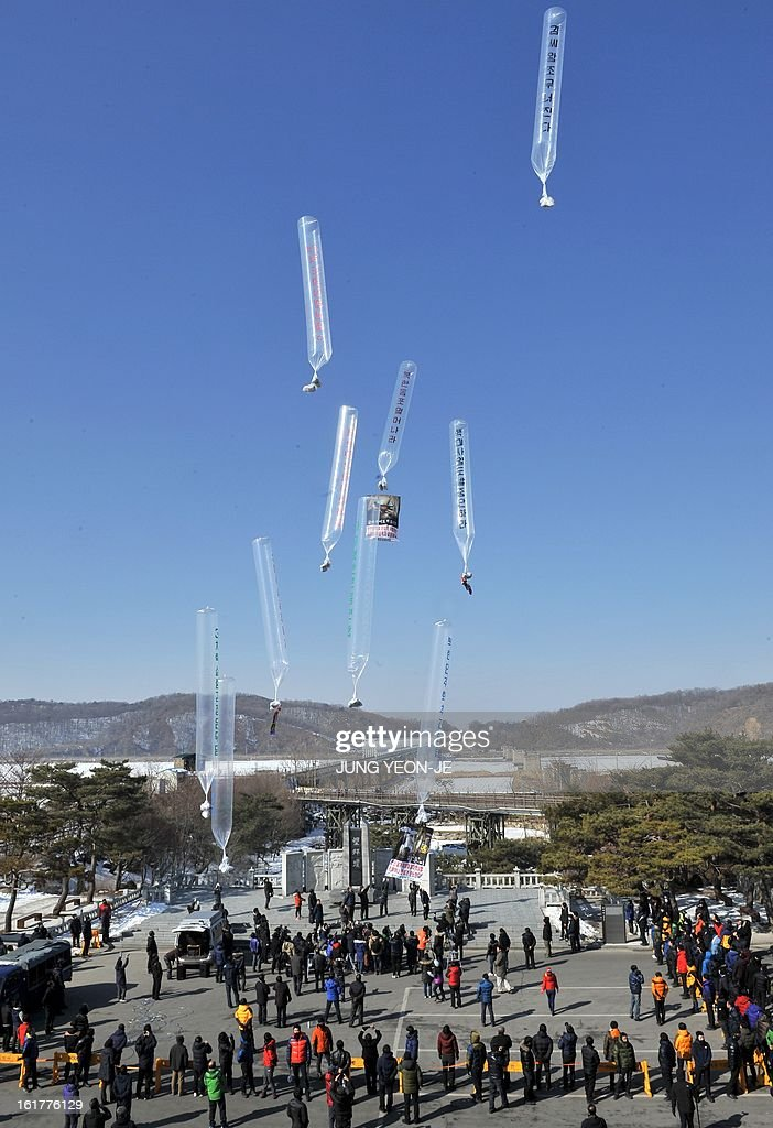 Former North Korean defectors living in South Korea float giant balloons carrying anti-Pyongyang leaflets at Imjingak park near the inter-Korean border in Paju on February 16, 2013. Activists launched balloons across the border carrying leaflets that criticise North Korea's ruling Kim family on the birth anniversary of late leader Kim Jong-Il, amid high tension over its long-range rocket launch and nuclear test.