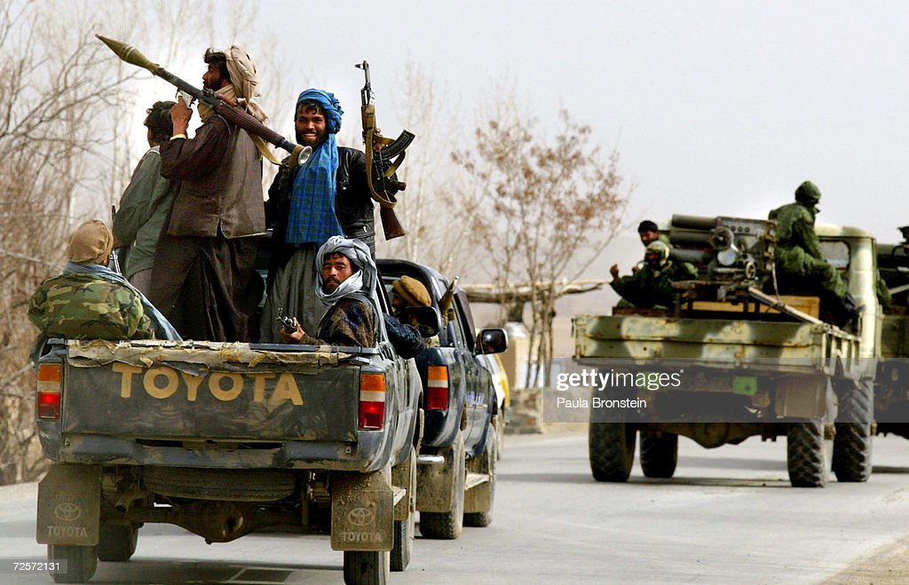Former Northern Alliance soldiers ride a vehicle March 8 2002 towards the town of Gardez in Afghanistan Between 700 to 1000 soldiers with...