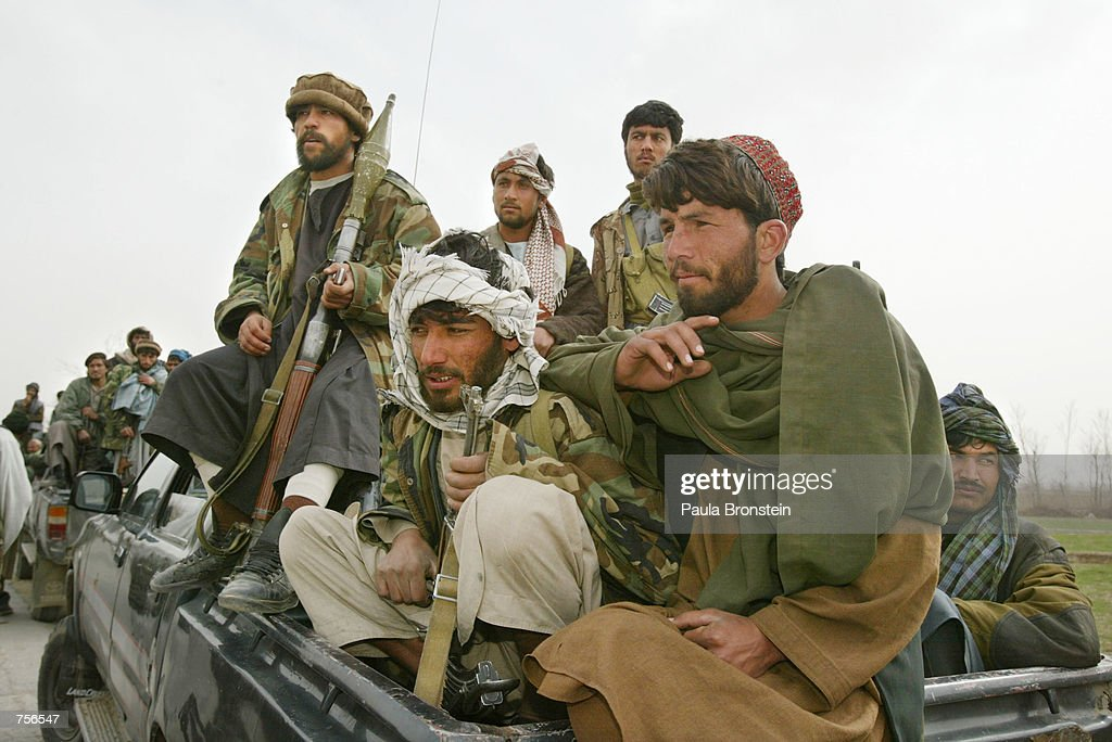 Former Northern Alliance soldiers travel towards the town of Gardez March 8 2002 in Afghanistan Between 700 to 1000 soldiers with 20 tanks are moving...