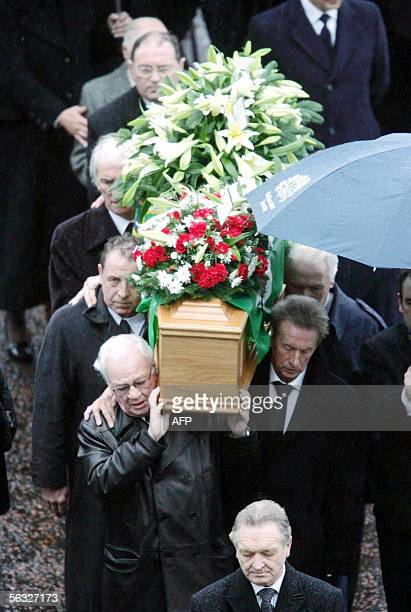 Former Northern Ireland manger Billy Bingham friend and team mate Dennis Law carry the coffin of Northern Ireland and Manchester United legend George...