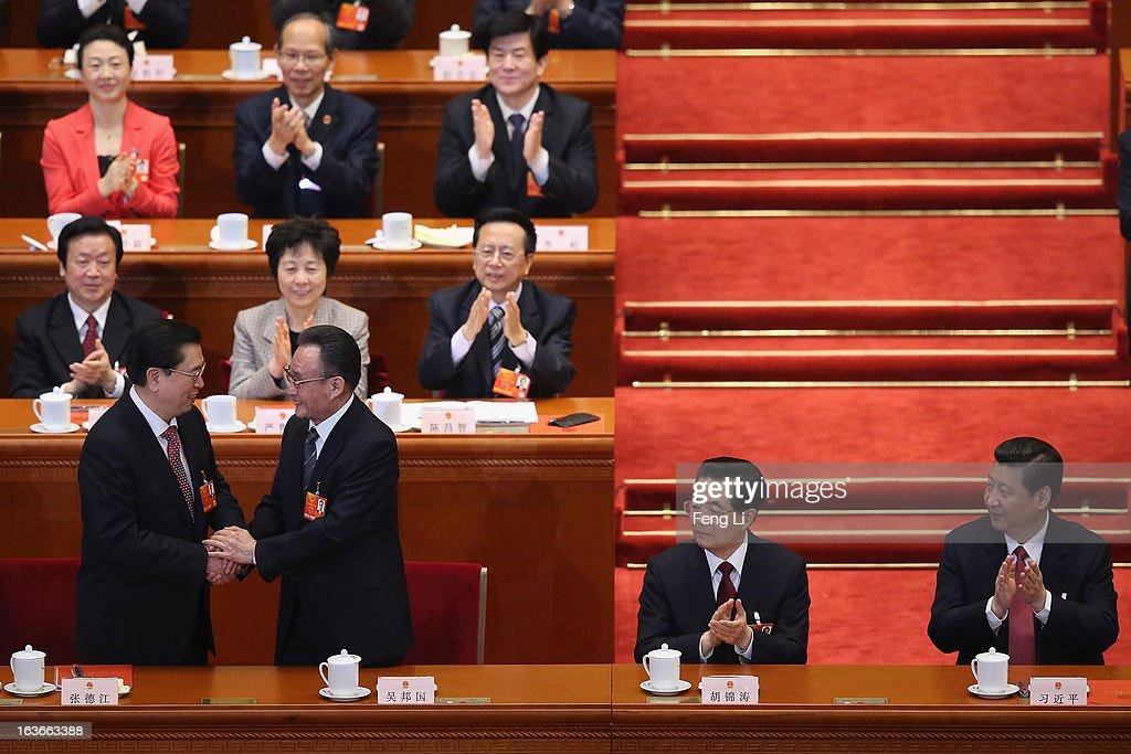 Former NPC Chairman Wu Bangguo shakes hands with newlyelected NPC Chairman Zhang Dejiang as China's newlyelected President Xi Jinping and former...