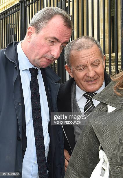 Former nurse of French L'Oreal heiress Liliane Bettencourt Alain Thurin leaves the court with his lawyer Benoit Chabert on October 5 2015 at the...