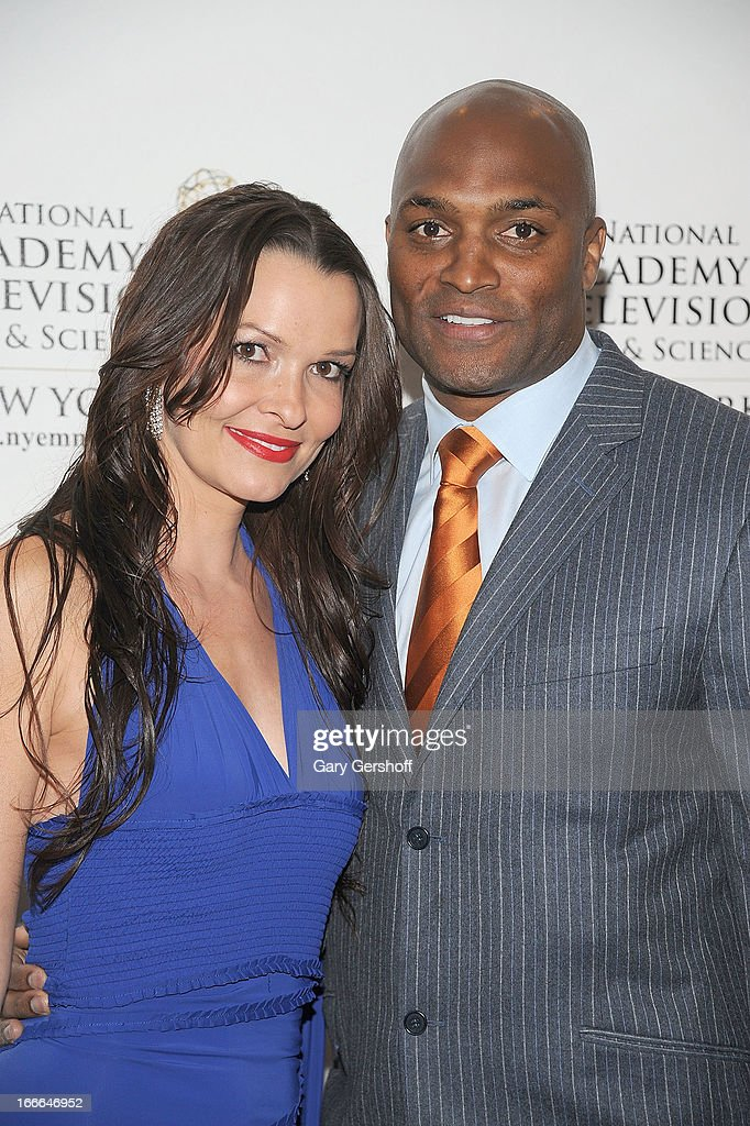 Former N.Y. Giants wide receiver <a gi-track='captionPersonalityLinkClicked' href=/galleries/search?phrase=Amani+Toomer&family=editorial&specificpeople=206160 ng-click='$event.stopPropagation()'>Amani Toomer</a> (R) and guest attend the 56th Annual New York Emmy Awards at Marriott Marquis Times Square on April 14, 2013 in New York City.