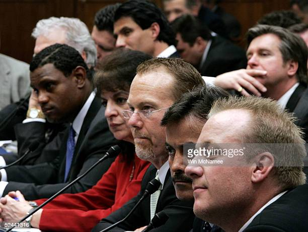 Former Oakland Athletics and Texas Rangers player Jose Canseco listens to testimony March 17 2005 for a House Committee session that is investigating...