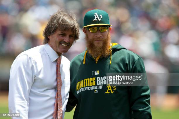 Former Oakland Athletics player Dennis Eckersley stands next to Sean Doolittle after throwing out the ceremonial first pitch before the game against...