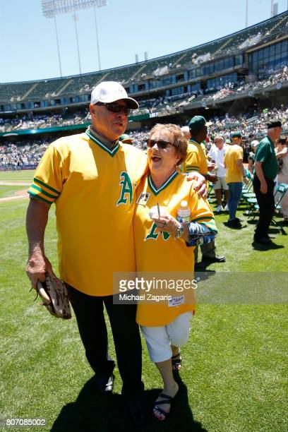 Former Oakland Athletics player Reggie Jackson talks with the widow of Catfish Hunter following a pregame ceremony before the game between the...