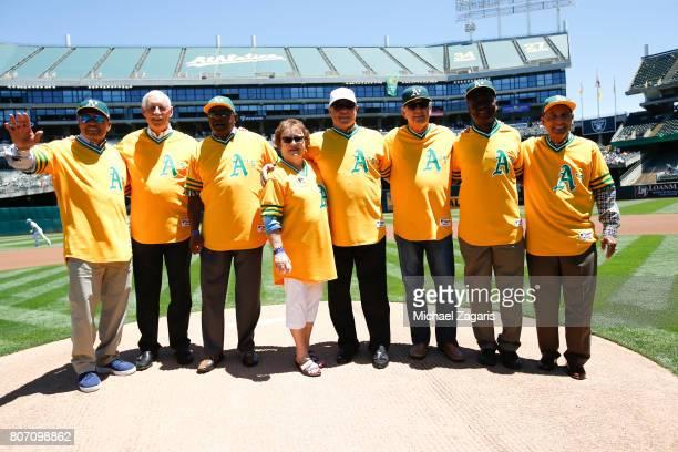 Former Oakland Athletics Reggie Jackson Joe Rudi Vida Blue Gene Tenace Darold Knowles John 'Blue Moon' Odom and Bert Campaneris stand with the widow...