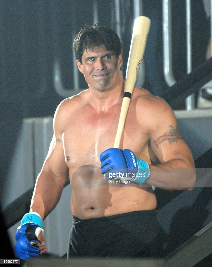 Former Oakland Athletics slugger <a gi-track='captionPersonalityLinkClicked' href=/galleries/search?phrase=Jose+Canseco&family=editorial&specificpeople=203063 ng-click='$event.stopPropagation()'>Jose Canseco</a> (L) walks to the ring with holding a bat prior to the match with Choi Hong-man at first Round of Super Hulk Tournament during Dream.9 at Yokohama Arena on May 26, 2009 in Yokohama, Kanagawa, Japan. Canseco lost at 1 minute 17 seconds in the first round.