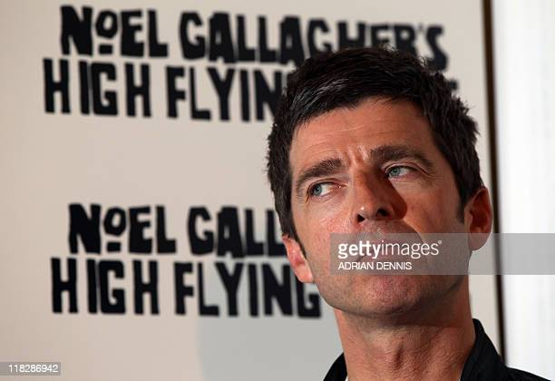 Former Oasis guitarist and songwriter Noel Gallagher poses for a photograph following a press conference announcing a new album 'Noel Gallagher's...