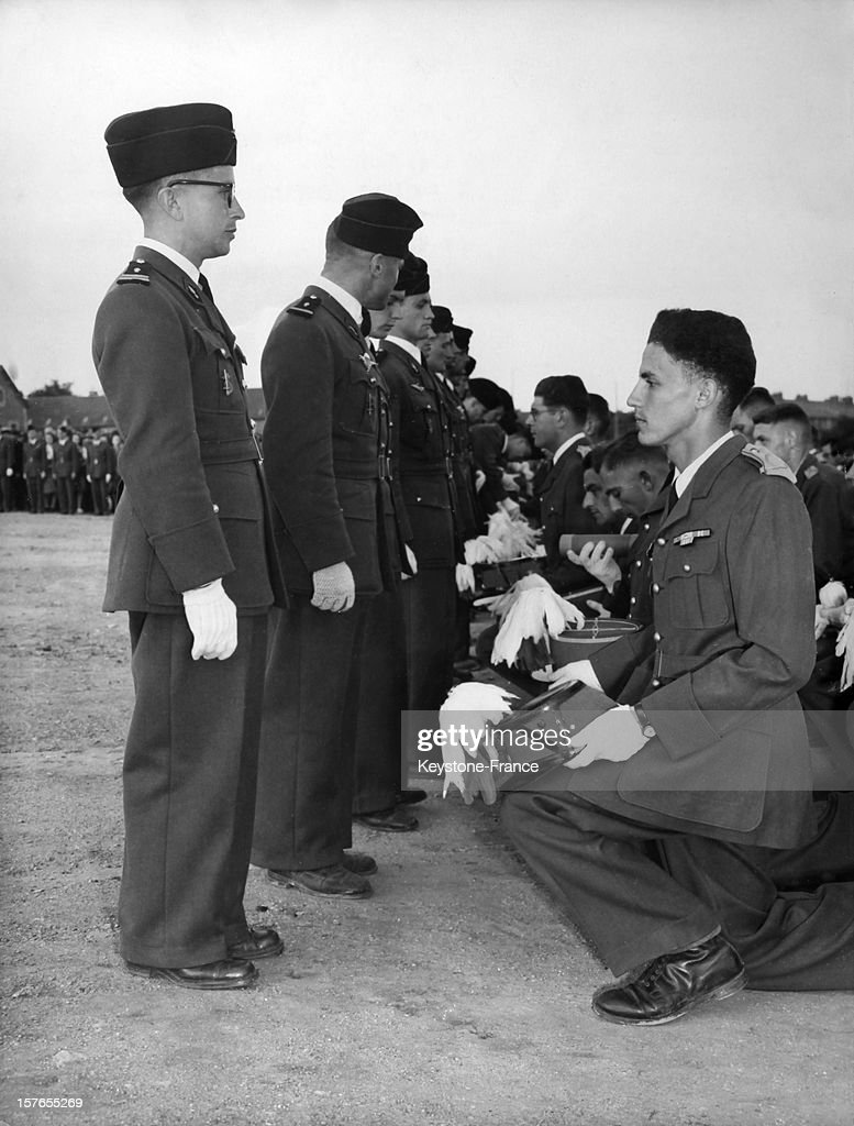 Former officer cadets of the French military school of Saint-Cyr presenting to the new officer cadets the traditional casoar during a Triomphe ceremony, in Saint-Cyr-l'Ecole, France, in 1939.