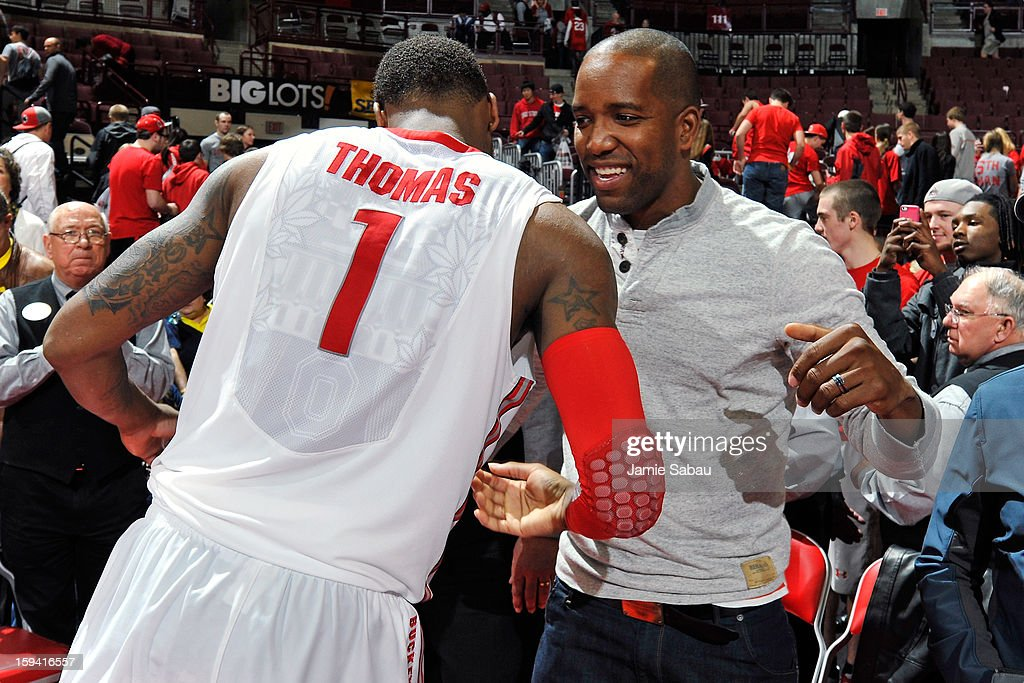 Former Ohio State and NBA basketball player Michael Redd congratulates Deshaun Thomas #1 of the Ohio State Buckeyes after the Buckeyes defeated the Michigan Wolverines 56-53 on January 13, 2013 at Value City Arena in Columbus, Ohio.