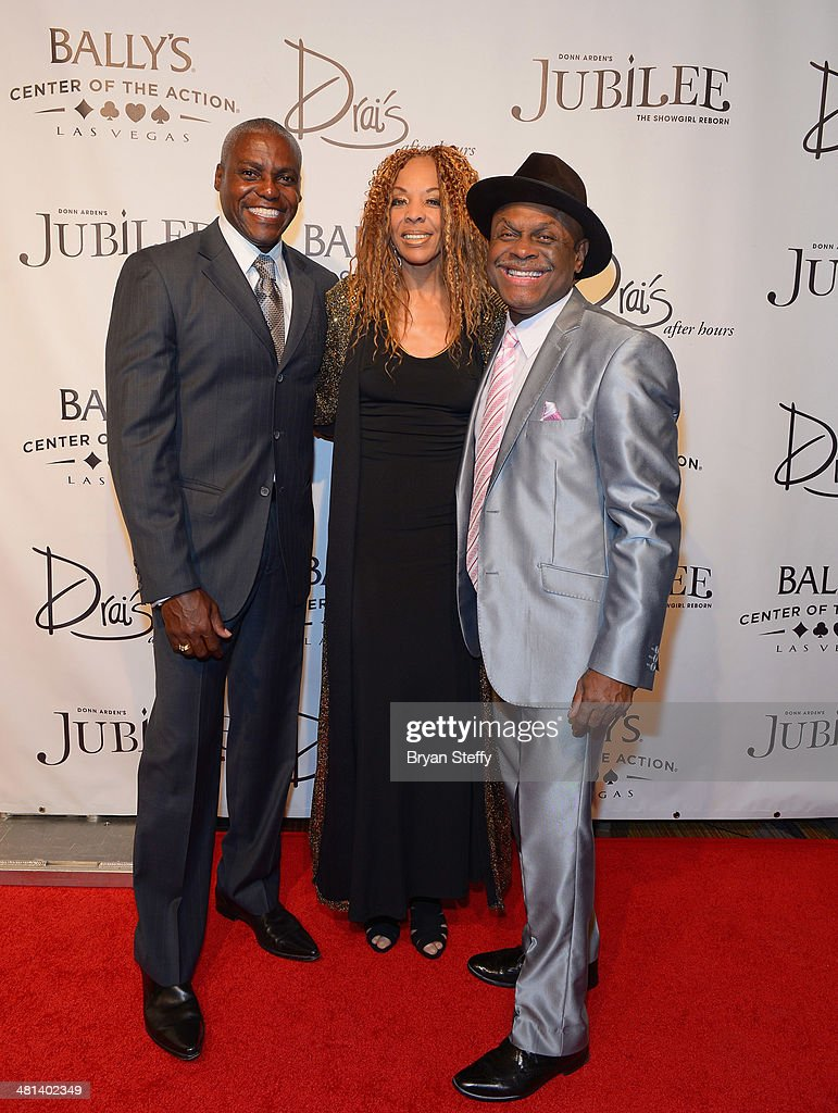 Former Olympian Carl Lewis, dancer/actress Carla Earle and comedian Michael Colyar arrive at the 'Jubilee!' show's grand reopening at Ballys Las Vegas on March 29, 2014 in Las Vegas, Nevada.