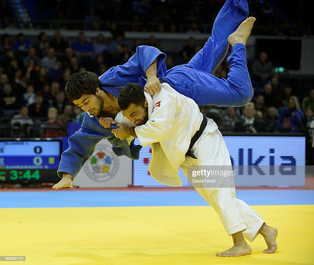 Former Olympic and World champion, <a gi-track='captionPersonalityLinkClicked' href=/galleries/search?phrase=Ilias+Iliadis&family=editorial&specificpeople=2258296 ng-click='$event.stopPropagation()'>Ilias Iliadis</a> of Greece (white) threw Shahin Gahramanov of Azerbaijan for ippon in their u90kgs contest at the Dusseldorf Grand Prix on day 2, Sunday, February 24, 2013 at the Mitsubishi Electric Halle, Dusseldorf, Germany.