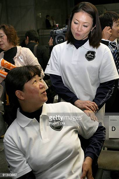 Former Olympic athlete Masami Tanaka talks with former Paralympic athlete Mayumi Narita after Tokyo was eliminated in the second ballot for the 2016...