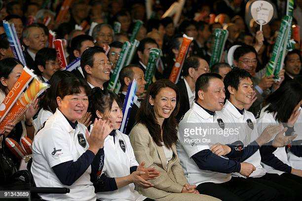 Former Olympic athlete Yuko Arimori smiles with the other audience as they receive the result of Tokyo remained in the contention in the first ballot...
