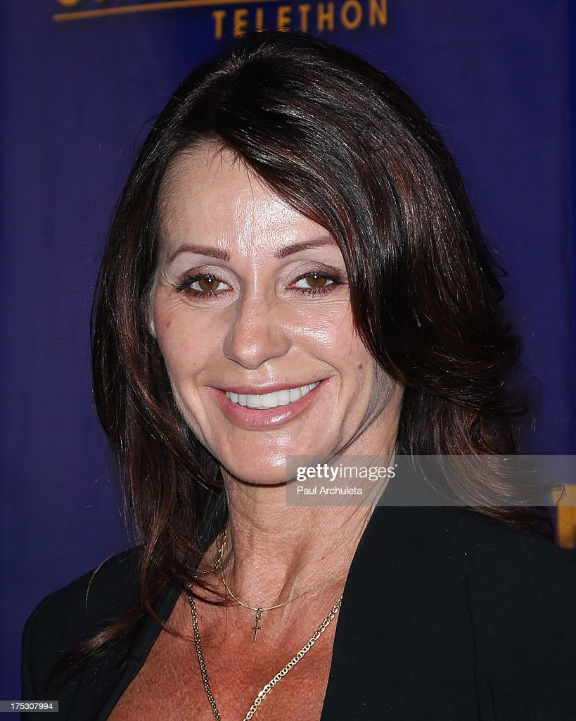 Former Olympic Athletes <a gi-track='captionPersonalityLinkClicked' href=/galleries/search?phrase=Nadia+Comaneci&family=editorial&specificpeople=212961 ng-click='$event.stopPropagation()'>Nadia Comaneci</a> attends the Muscular Dystrophy Association's 48th annual MDA Show Of Strength telethon day 2 at CBS Studios on August 1, 2013 in Los Angeles, California.
