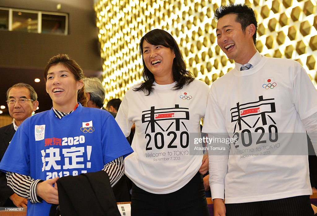 Former Olympic athletes <a gi-track='captionPersonalityLinkClicked' href=/galleries/search?phrase=Saori+Yoshida&family=editorial&specificpeople=2374710 ng-click='$event.stopPropagation()'>Saori Yoshida</a>, Ai shibata and <a gi-track='captionPersonalityLinkClicked' href=/galleries/search?phrase=Junichi+Miyashita&family=editorial&specificpeople=2089969 ng-click='$event.stopPropagation()'>Junichi Miyashita</a> reacts after it was announced that Tokyo has won the bid to host the 2020 Summer Olympic Games during the viewing of 2020 Summer Olympic Games host city announcement at Tosho Hall on September 8, 2013 in Tokyo, Japan. Madrid was the first city to be eliminated, followed by Istanbul. Tokyo won the right to host the 2020 Summer Olympic Games, defeating Istanbul in the final ballot.