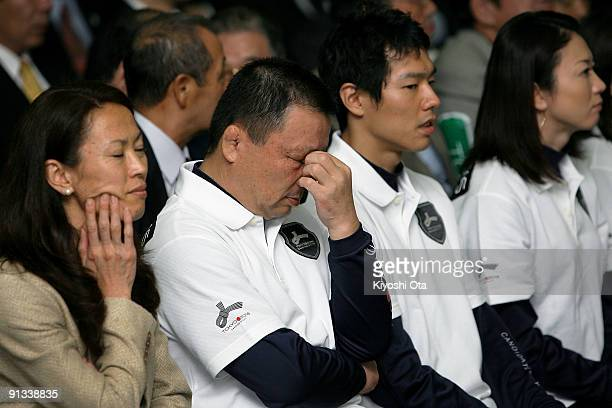 Former Olympic athletes Yuko Arimori Mitsuo Nagatomo Hisashi Mizutoshi and Masami Tanaka react as they receive the result of Tokyo being eliminated...