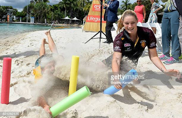 Former Olympic Beach Volleyball Gold medalist Natalie Cook and AllAustralian AFL player Tayla Harris dive for the markers as part of the official...