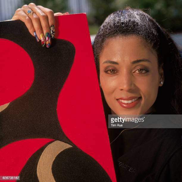 Former Olympic gold medalist Florence Griffith 'Flojo' Joyner poses with her own painting in the backyard of her former home Joyner died in 1998...