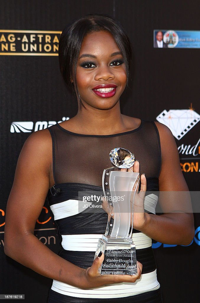 Former Olympic Gold Medalist Gabrielle 'Gabby' Douglas poses with her Icon Award during the 6th annual Diamond in the RAW-Action Icon Awards at Skirball Cultural Center on November 10, 2013 in Los Angeles, California.