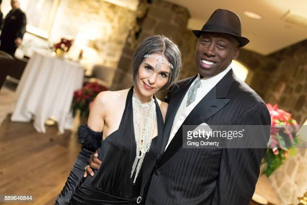 Former Olympic Triple Jump Gold Medalist Al Joyner and girlfriend Cindi attend The Thalians Hollywood for Mental Health Holiday Party 2017 at the Bel...