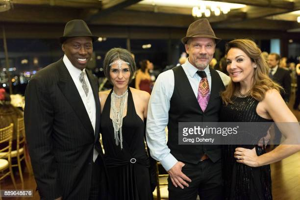 Former Olympic Triple Jump Gold Medalist Al Joyner and girlfriend Cindi and Josh Carmichael and Jill Michele Melean attend The Thalians Hollywood for...