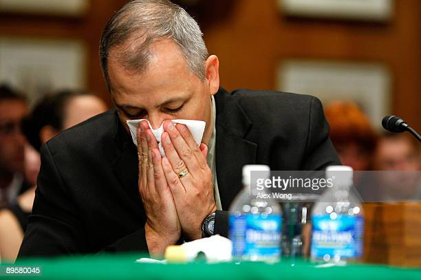 Former Oregon Army National Guard Staff Sergeant Rocky Bixby coughs as he testifies during a hearing before the Senate Democratic Policy Committee on...