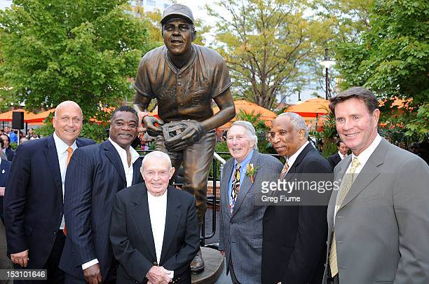Former Oriole Brooks Robinson poses for photos with former Orioles Cal Ripken Jr Eddie Murray Earl Weaver Frank Robinson and Jim Palmer at a ceremony...