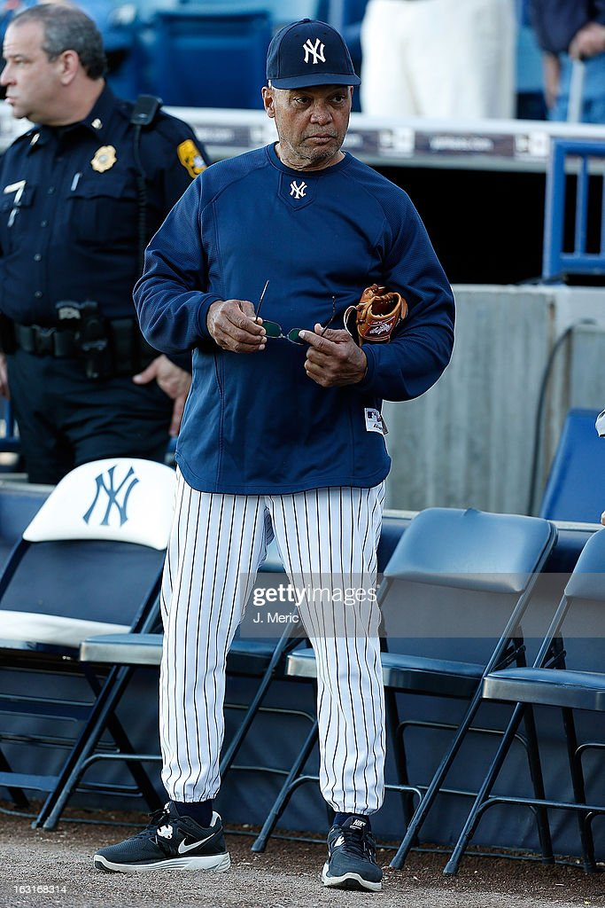 Former outfielder Reggie Jackson #44 of the New York Yankees watches batting practice just before the start of the Grapefruit League Spring Training Game against the Atlanta Braves at George M. Steinbrenner Field on March 5, 2013 in Tampa, Florida.